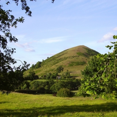 Guided walking in Shropshire Hills - Caer Carodoc at a distance